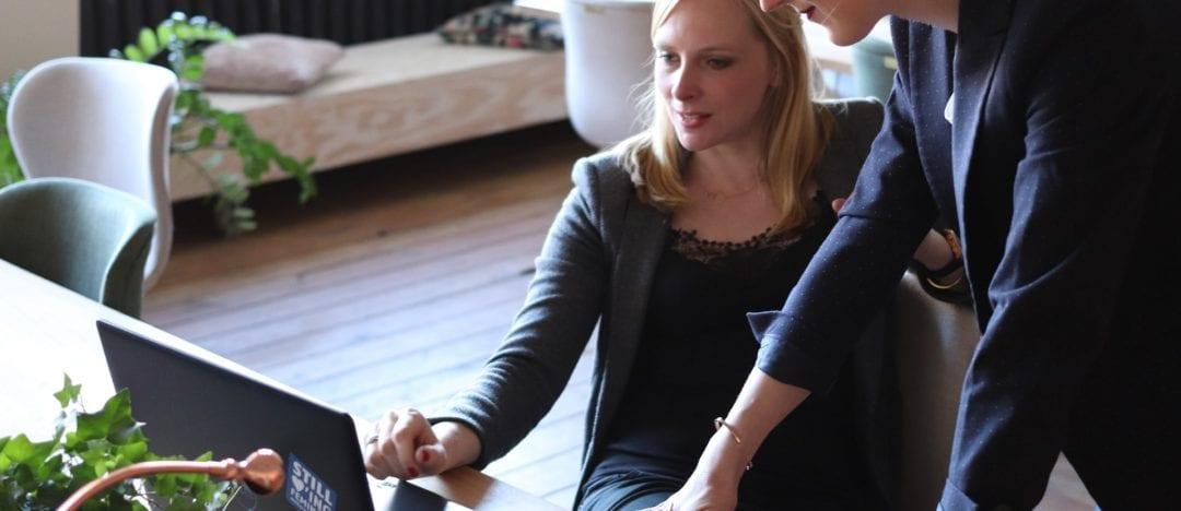 2 women looking at laptop